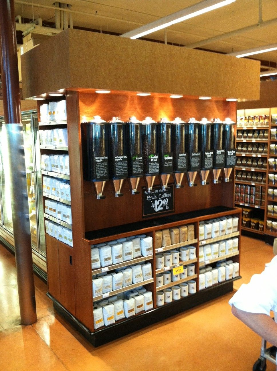 The Original Coffee Bean Hoppers Display Different Coffee Blends For International Metro Markets Coffee Display Coffee Bean Shop Coffee Shop