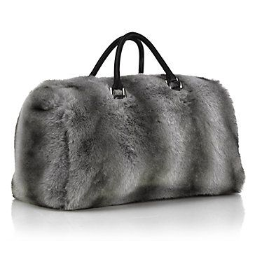 6a56b251f9e7 Travel in style with our impossibly chic Natasha Fur Bag in grey ...