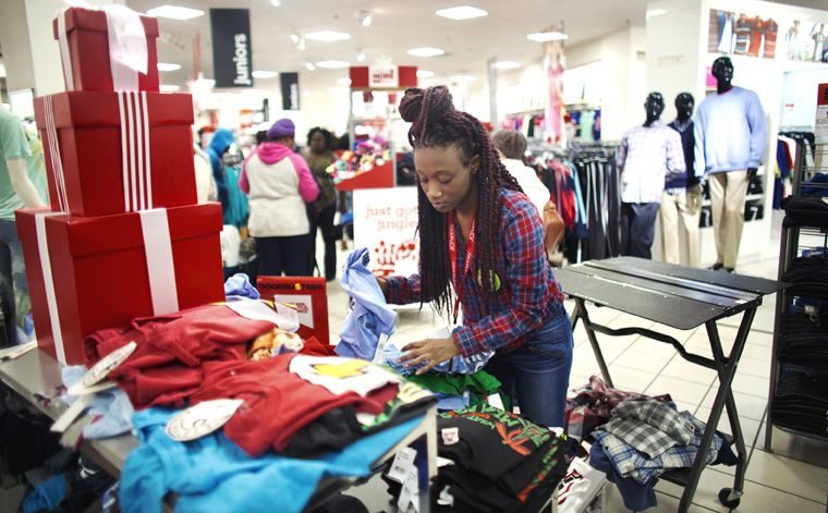 Markeah Nembhard, an employee at J.C. Penney, sorts and