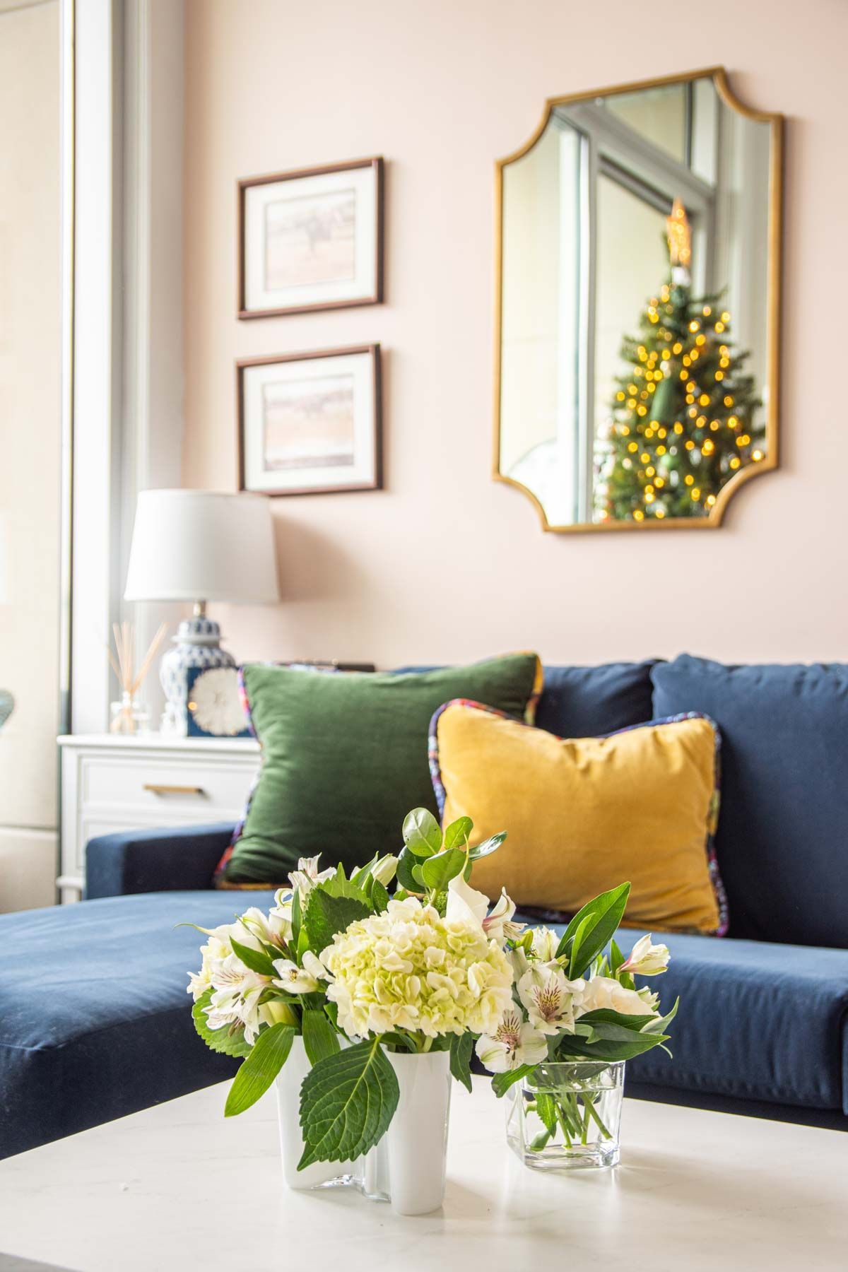 Jewel-tone Christmas tree holiday decor with tassels and boho style from SmithHönig in apartment living room by Kevin O'Gara on Thou Swell | Holiday Decorations living room #christmas #christmastree #christmasdecor #holidaydecor #bohodecor #bohochristmas #tassels #smithhonig #apartment #apartmentdecor #livingroomdesign