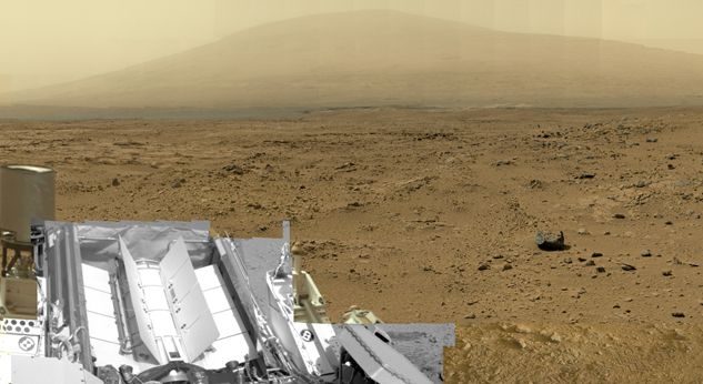 """This is a reduced version of a mosaic from NASA's Mars rover Curiosity containing 1.3 billion pixels in the full-resolution version. It shows Curiosity at the """"Rocknest"""" site, where the rover scooped up samples of windblown dust and sand. Viewers can explore this image with pan and zoom controls at http://mars.nasa.gov/bp1/. Read the Full Story."""
