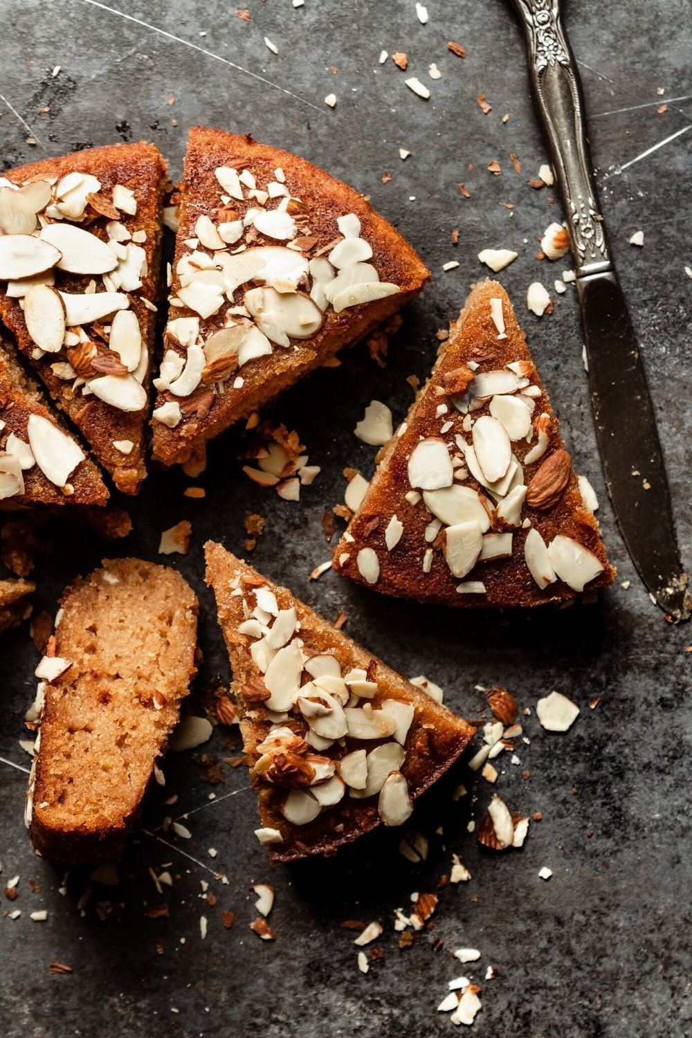 An easy honey cake soaked with honey and topped with almonds.