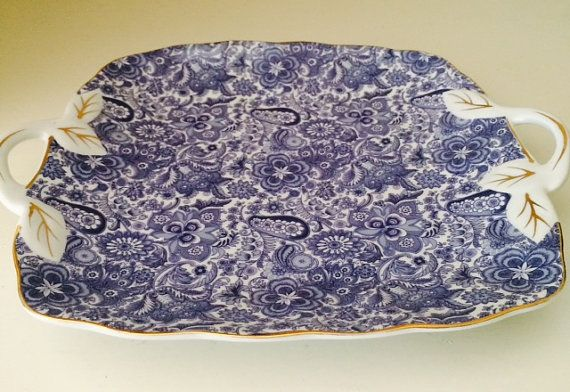 Give your home a pop of color with this preppy paisley blue and white catch-all. Use it for your keys, baubles or display it solo on your