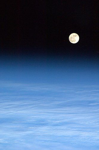 The Moon rising over Earth seen from the orbit