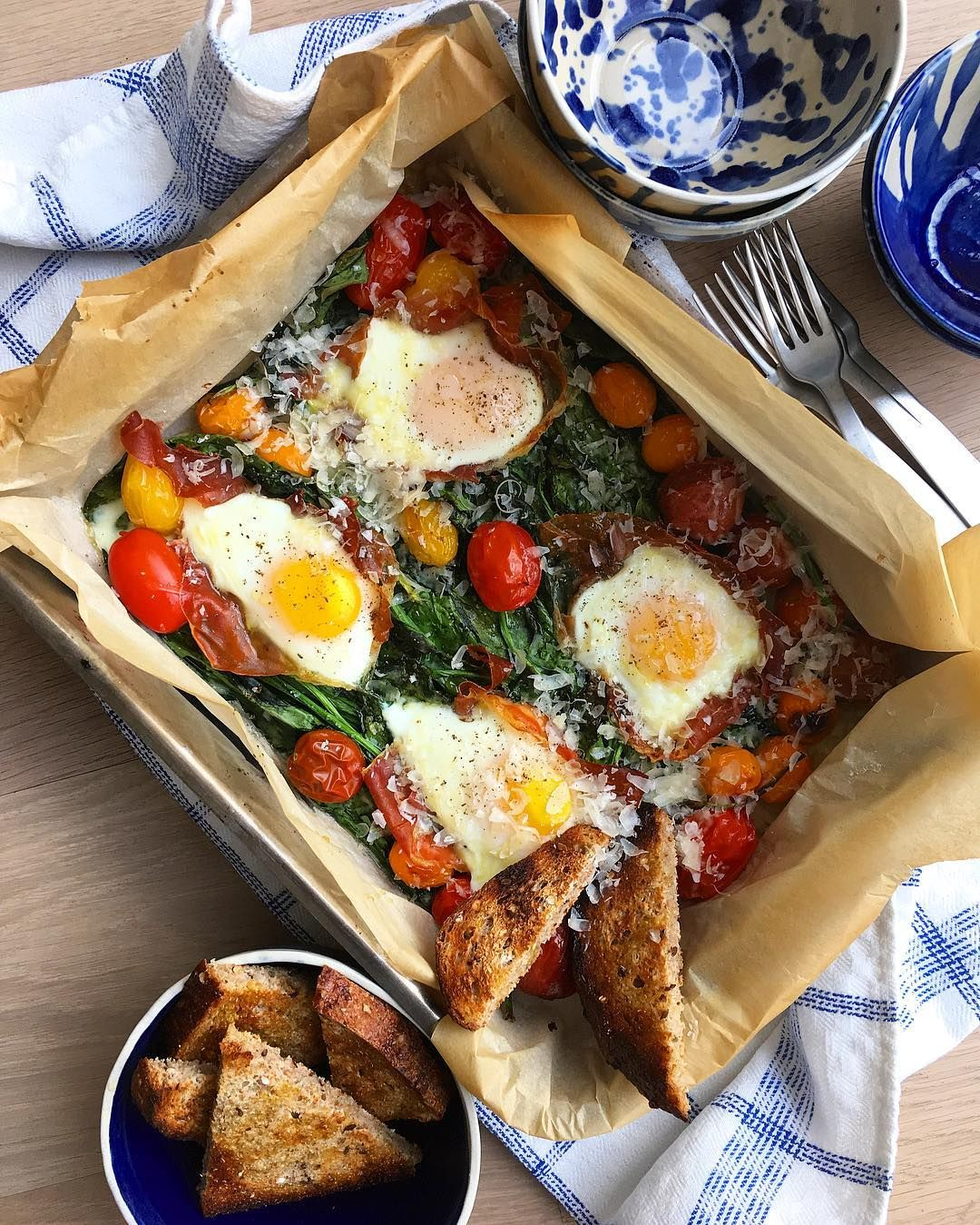 fast + healthy breakfast. spinach, tomatoes, prosciutto + eggs.