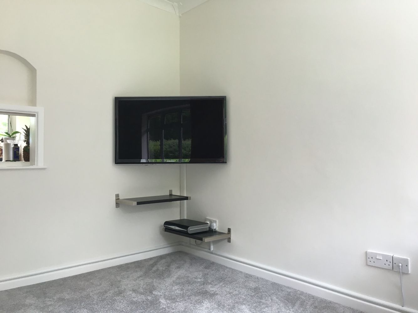 corner tv mount and floating shelves quite pleased with. Black Bedroom Furniture Sets. Home Design Ideas