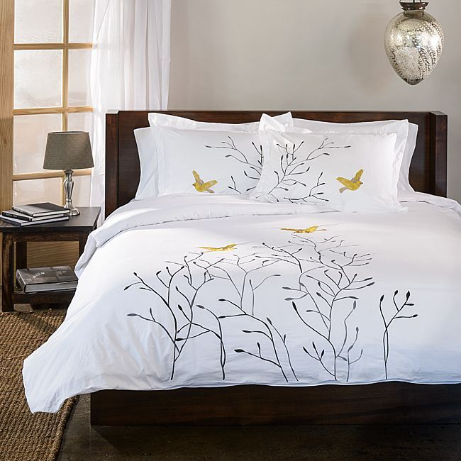 make your bedroom a pleasant retreat with this gorgeous threepiece white duvet cover set the simple duvet cover features embroidered swallows fluttering