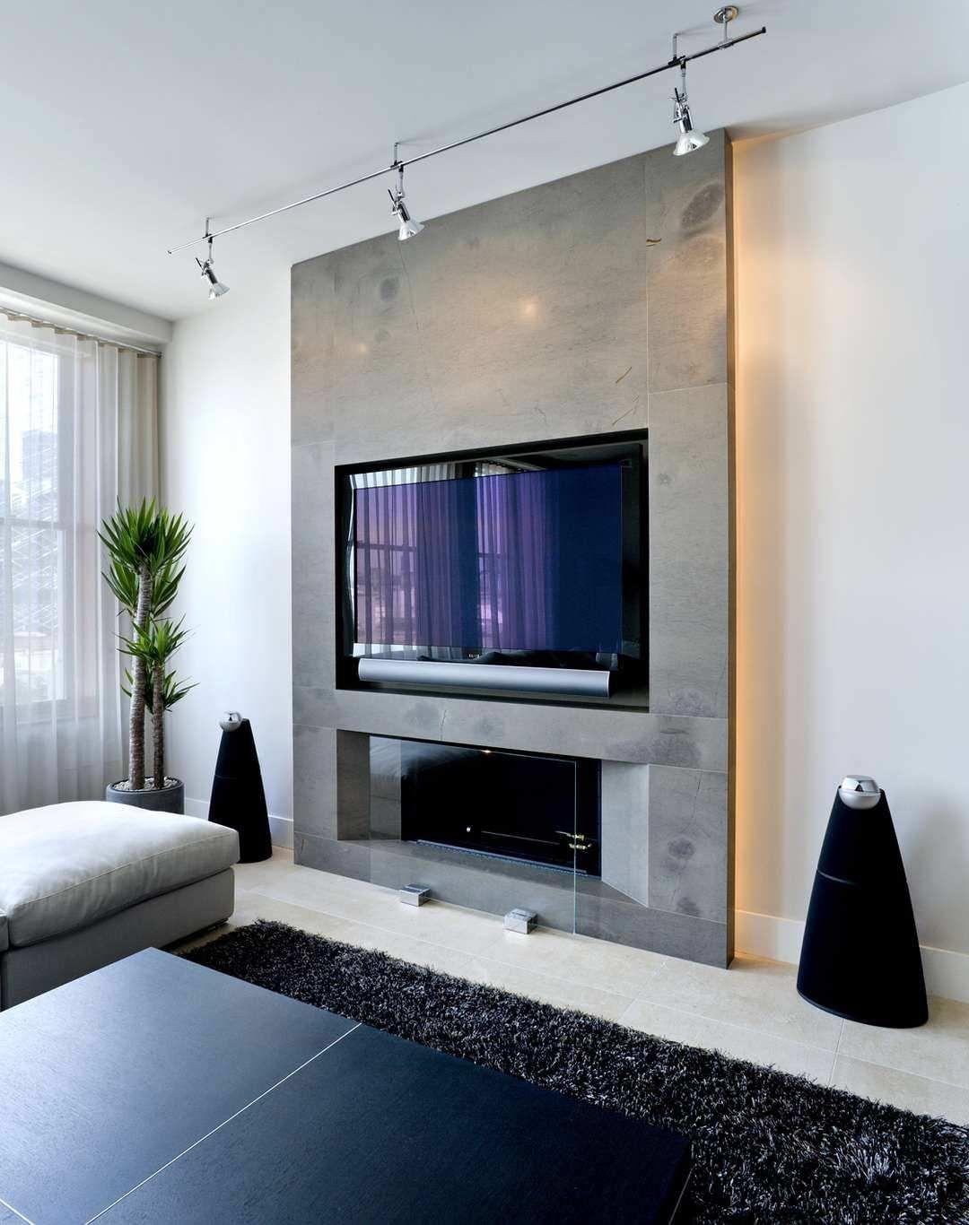 Parete attrezzata in cartongesso per un soggiorno moderno for Living con camino