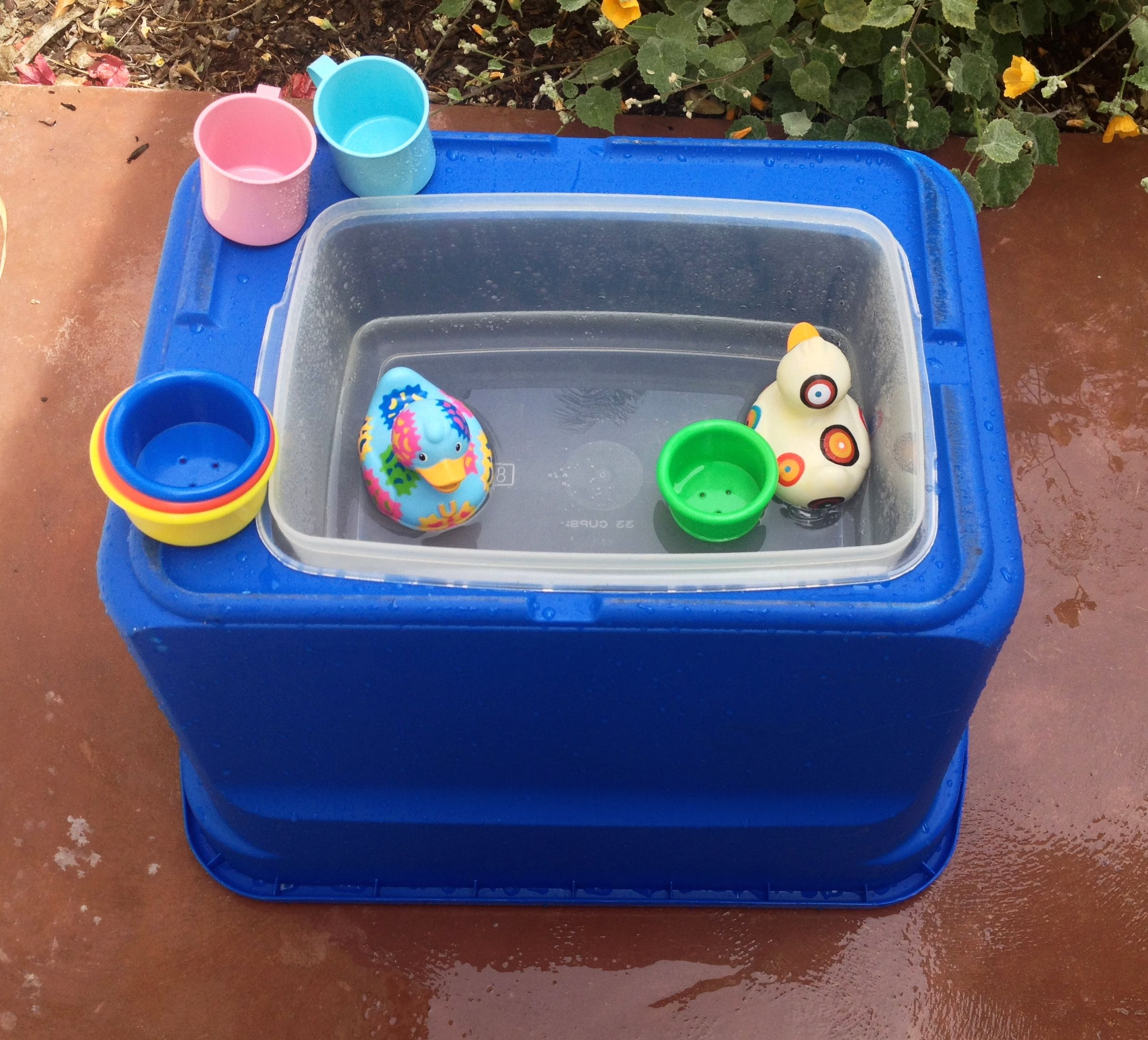 DIY water table! large plastic storage tub turned over... cut hole ...