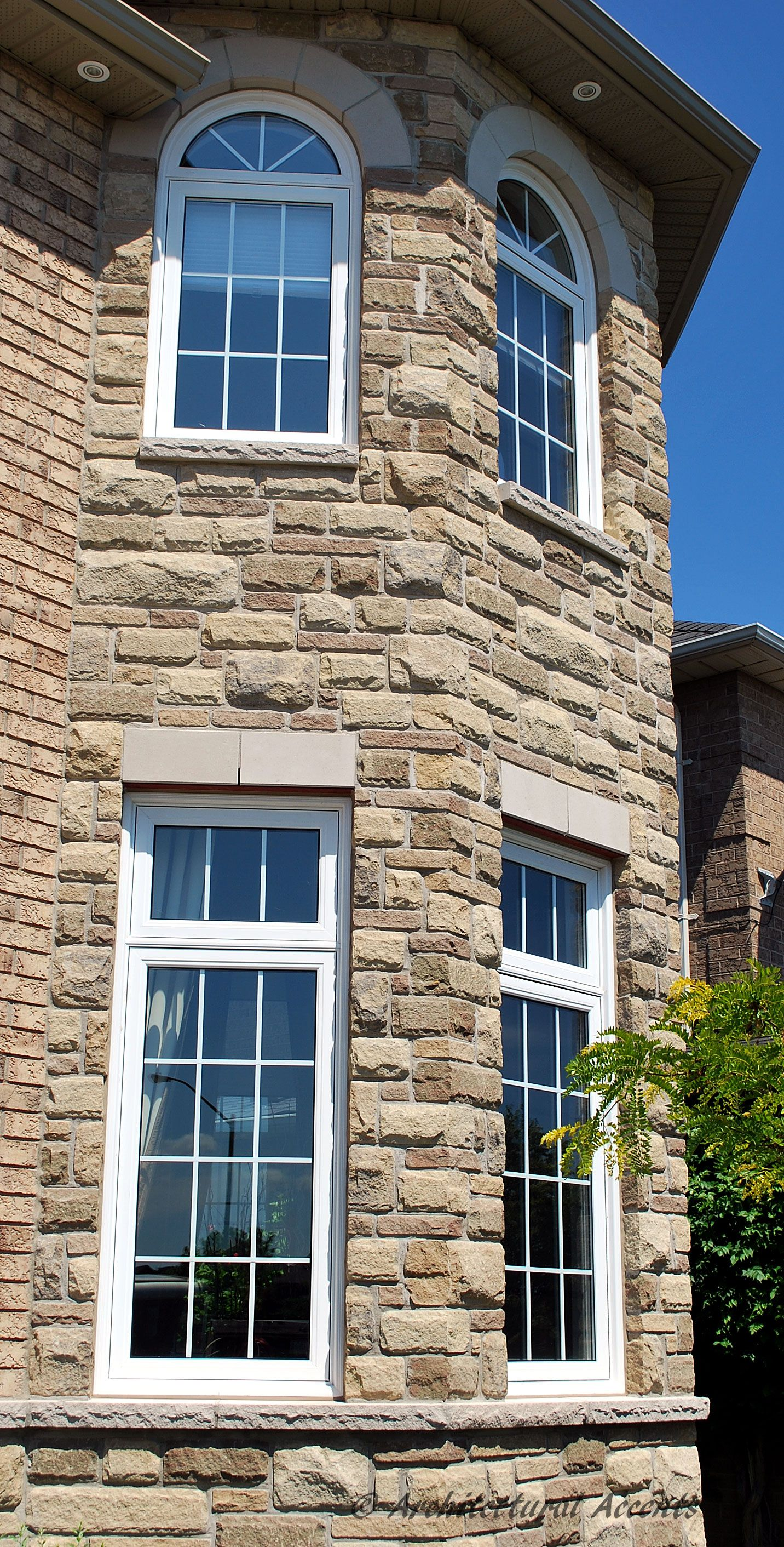 Single Casement Window With Transom Plus Arched Transoms On The Second Floor Vinyl Brick Mould
