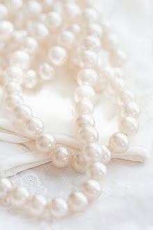 A girl can go far with her strand of pearls.   