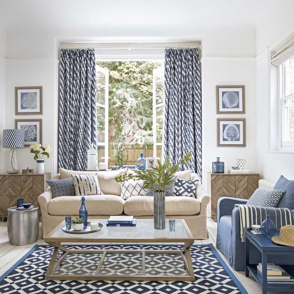 Coastalinspired living room with oak furniture and cream sofa