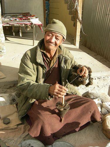 Leh, Ladakh, India: man spinning yak fiber