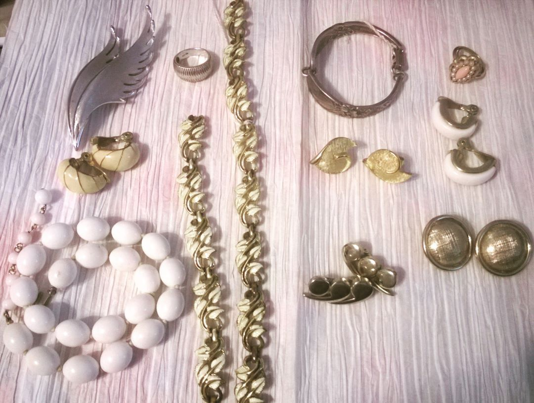 Some vintage pieces: necklaces, earrings, bracelets, rings, and a brooch.