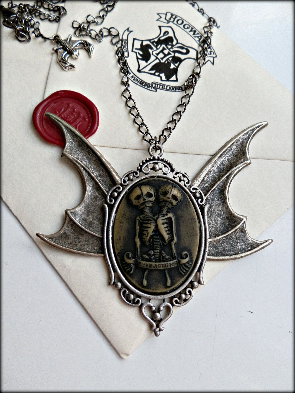 Conjoined skeleton bat wing cameo necklace.