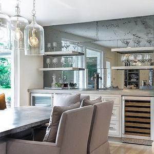 Antiqued Mirrored Backsplash Transitional Dining Room