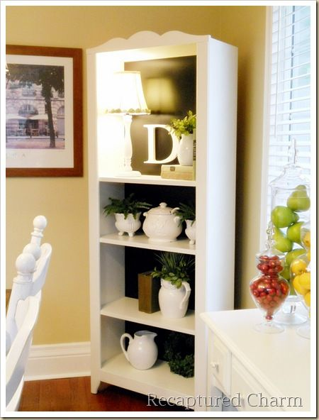 A Simple White Bookshelf Dramatically Changes With Some Black Paint
