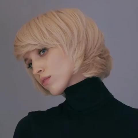 Fashionable shaggy haircut for medium hair.