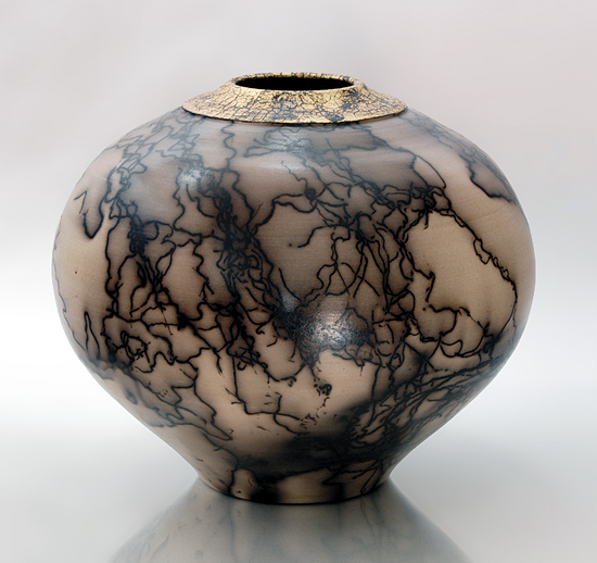 gold fired ceramic vessel by ron mello inspired by japanese and native