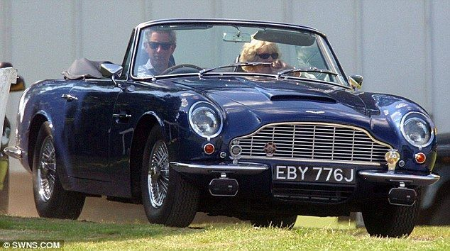 Long-lasting: The Prince, seen with wife Camilla Parker-Bowles, still drives the Aston Martin