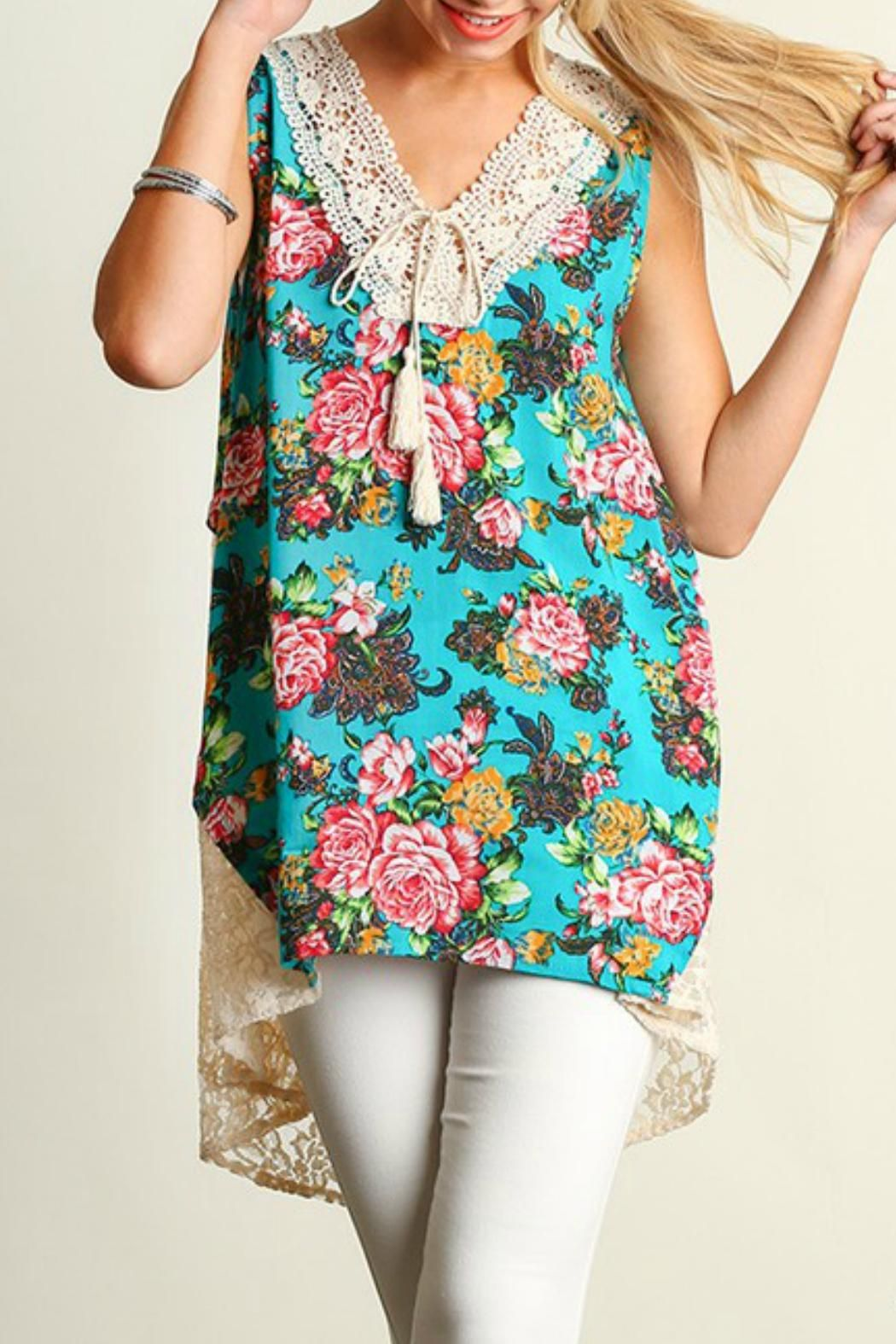 9b0db81f465 This tunic has a lace v neck with tassel ties and high-low lace hem line.  Be Jaded Floral-Lace Tunic by Umgee USA. Clothing Clothing ...