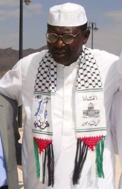 """All in the family! 01-29-14 Barack Obama's half brother, Malik Obama, wearing a Hamas scarf at a  2010 conference in Sanaa, Yemen. The text is the Palestinian slogan """"Jerusalem is ours – We are coming"""" and a map with the phrase """"From the river to the sea,"""" referring to the elimination of Israel, which lies between the Jordan River and the Mediterranean Sea. The govt of Egypt is investigating Malik for ties to Sudan's Islamic Dawa Org and its umbrella group, the Muslim Brotherhood."""