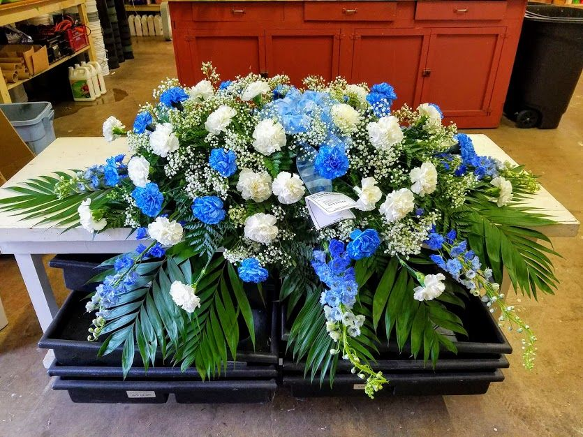 Blue And White Casket Spray Casket Sprays Blue Carnations Green Carnation