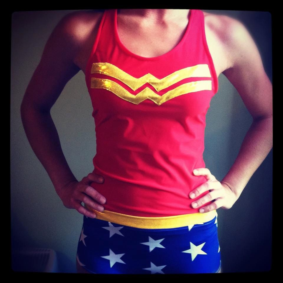 This is a custom made Wonder Woman running costume made from Under Armour Heat Gear fabric. The tank top has a comfortable racerback design which allows for swift and easy movement. The blue and white star long compression shorts allow for ultimate swiftness! This running costume wicks away moisture and keeps the runner cool and dry.