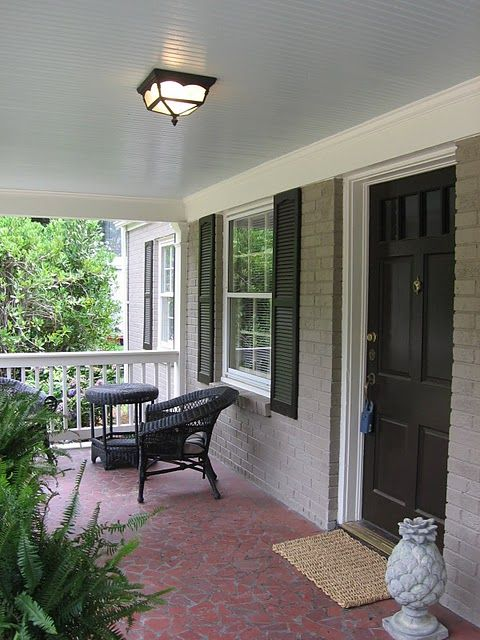 Bungalow Front Porch With Broken Tile Floor