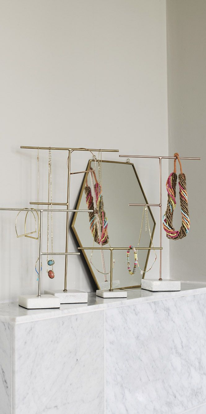 Combining a sleek and weighty marble base with structural metallic lines, our minimalist Metal & Marble Jewellery Stands allows your jewellery to make the statement.