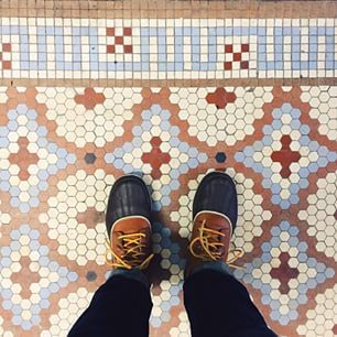 Another vintage mosaic tile floor with shoes.