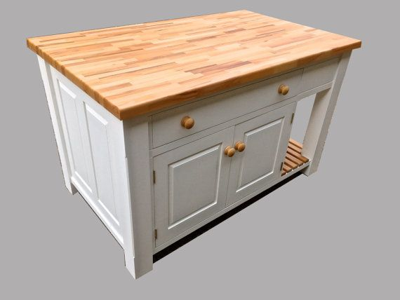 Hand painted kitchen island unit  Solid pine kitchen island unit made in our workshop. The unit has 4 inch legs, raised and fielded panels, and dovetailing to all the drawers. The unit can come in a colour of your choice, and either a beech or oak work top. The unit has two slatted shelves, and and an opening cupboard with two doors. The unit also has two drawers, one on the end and one on the side. The unit shown in the pictures is 120cm wide, 80cm deep, and 90cm high. This unit is made in…