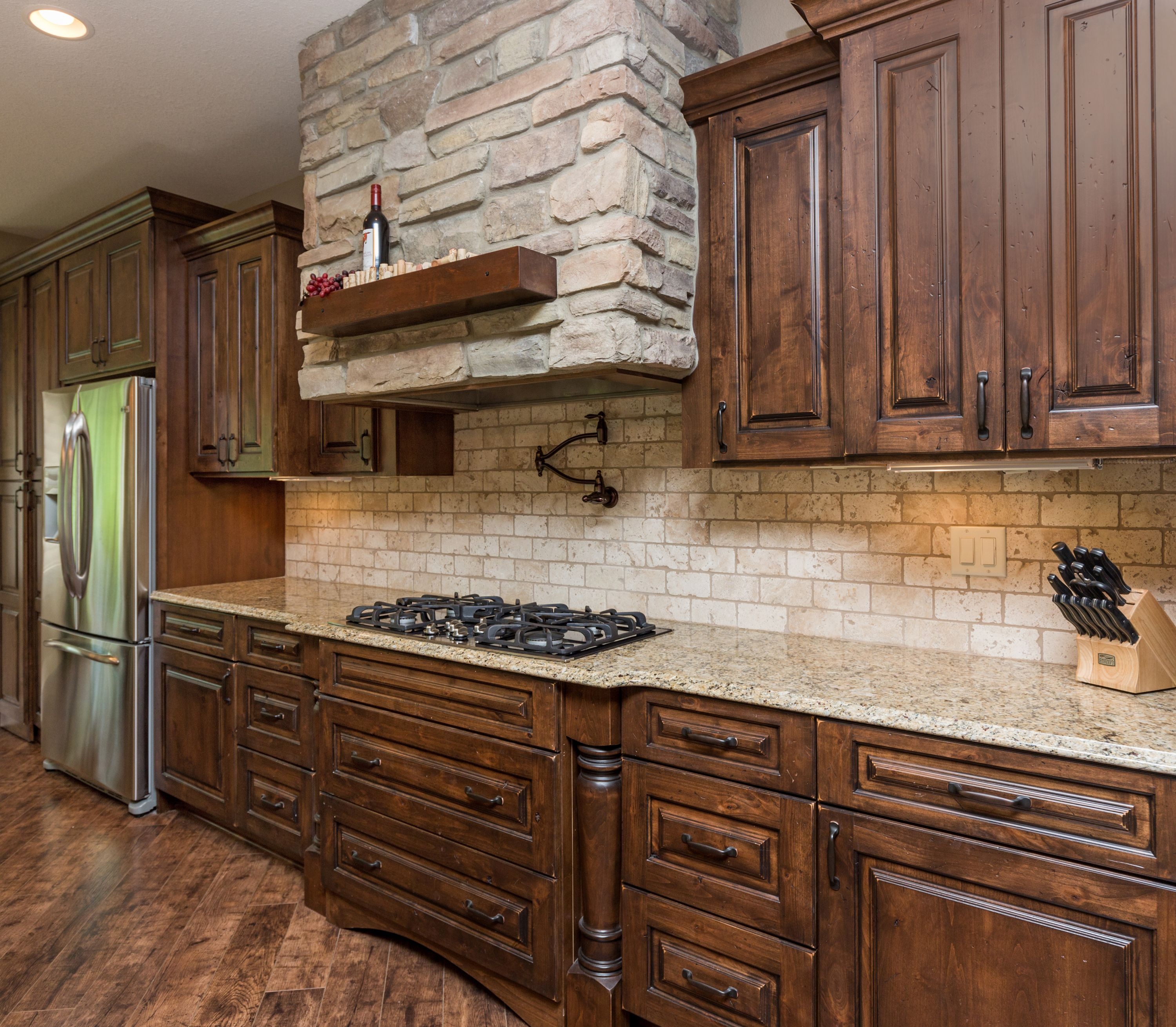 Travertine Floor White Cabinets Travertine Countertops: Stone Hood Vent With Wood Ledge, Travertine Backsplash, Distressed Stained Cabinets