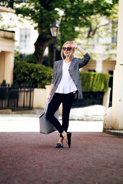 white peplum top, black and white blazer, black skinny pants, black patent leather loafers, gray tote