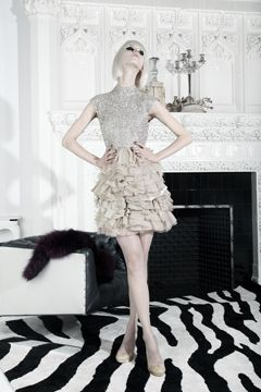 Alice + Olivia... It's a bit over the top with all the white, but they dress is way cool!