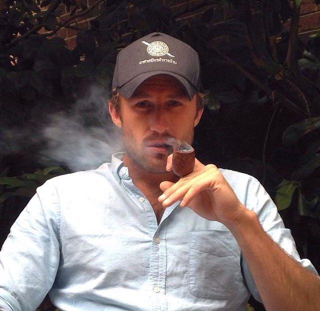 gay man pipe smoking