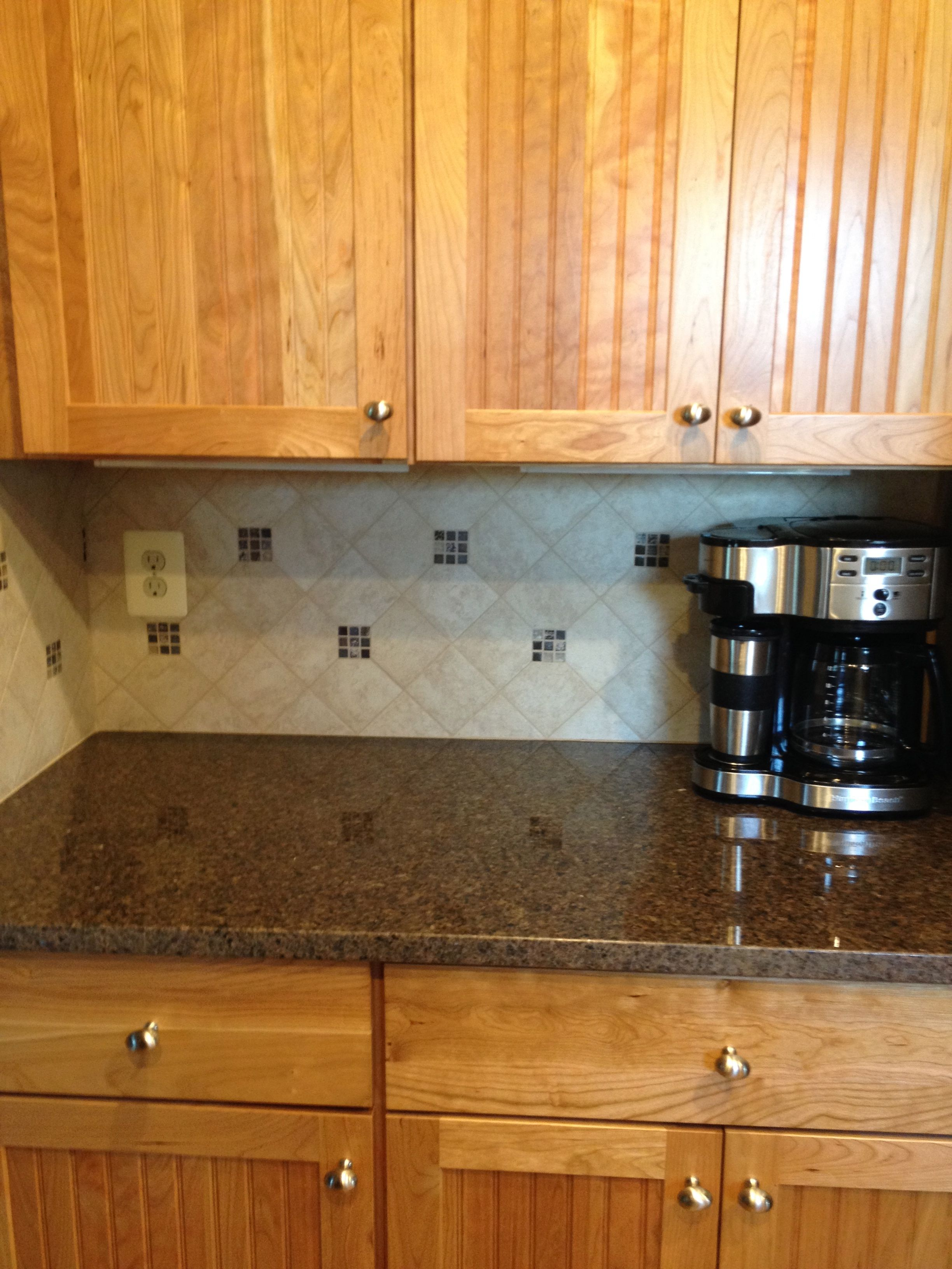 Kitchen remodel. Maroon Costar Granite Countertop with tile ... on
