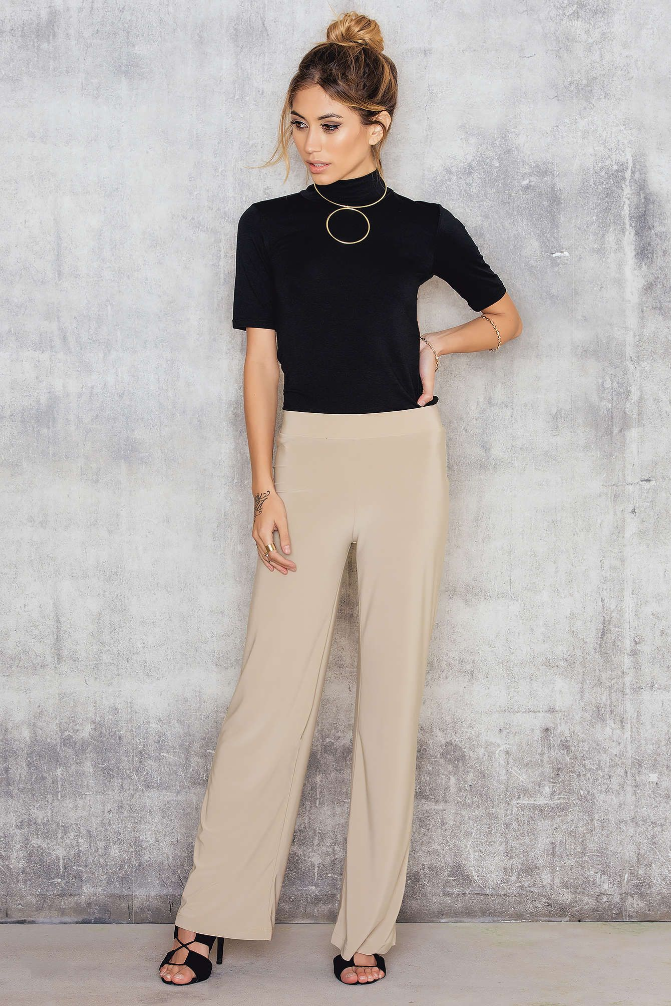 f74ed591 The perfect pants inbetween classy and comfy! The Gro Pants by Sisters Point,  comes in camel and features an elastic waist and wide legs.