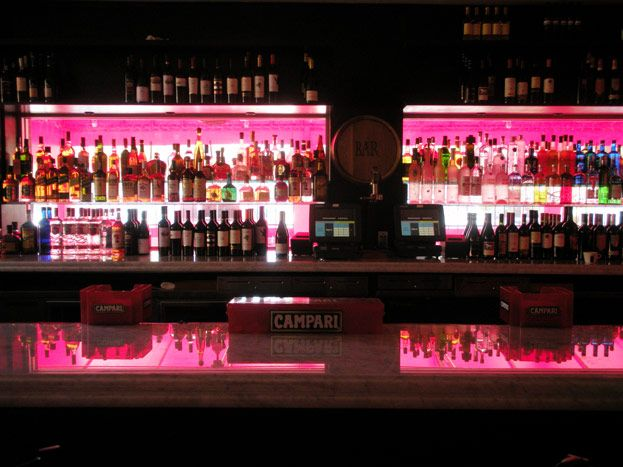 Red Lighting Illuminates The Back Of The Bar. Photo: SLK Creative