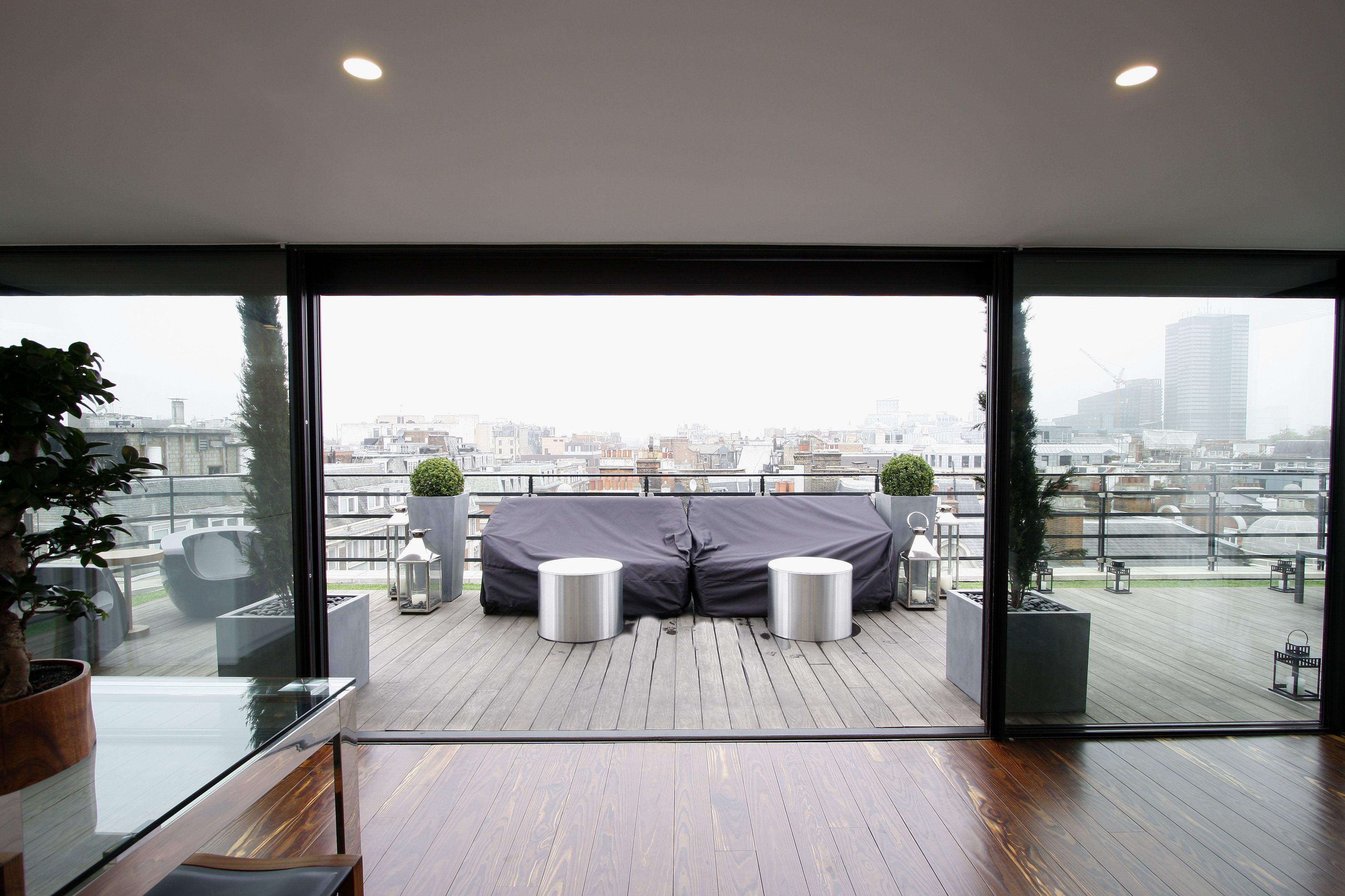Biparting Minimalwindows On Roofterrace Sliding Glass Door Rooftop Design Minimal Windows