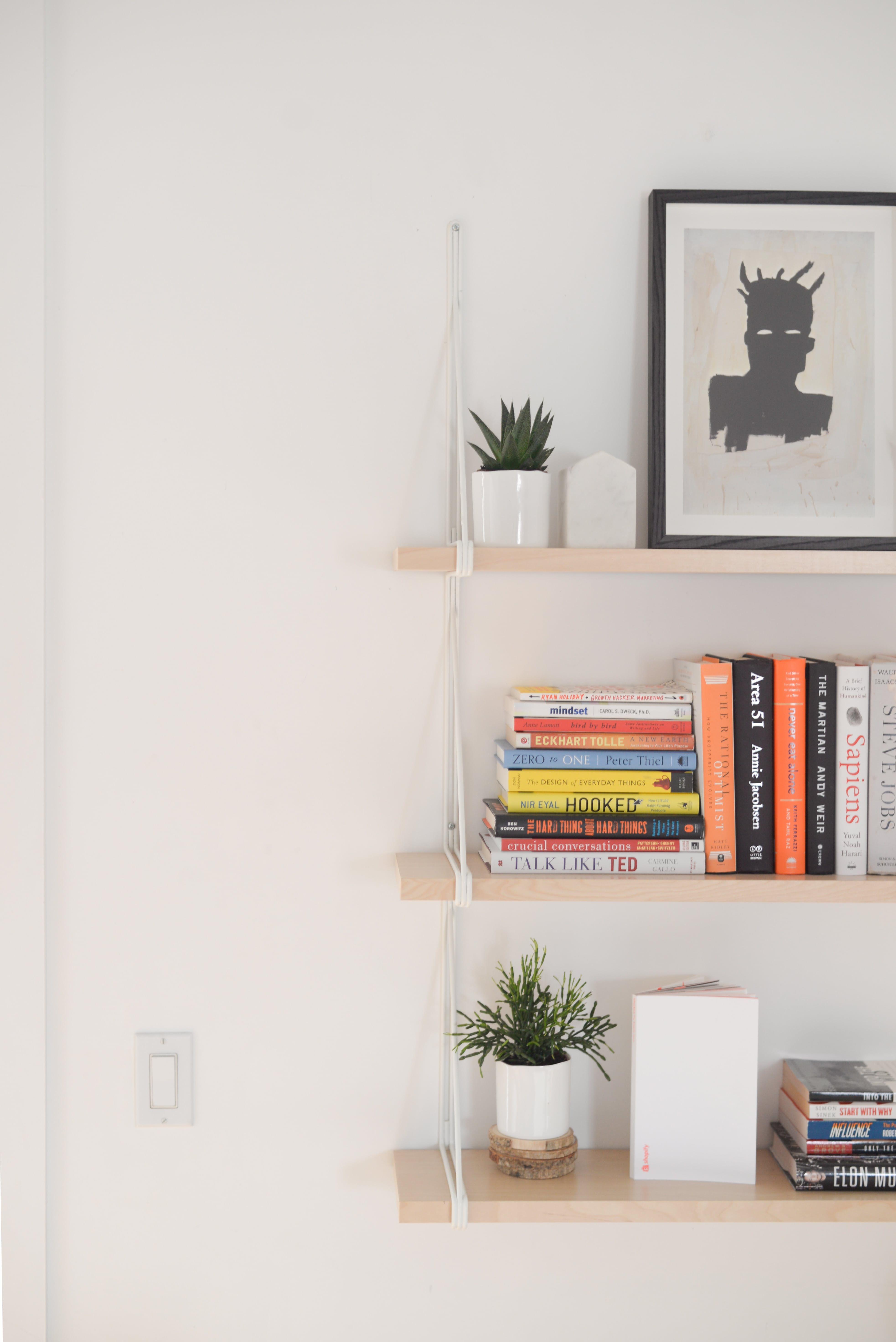 A Modern Balance Of Clean Lines Character In A Toronto Loft Hanging Bookshelves Bookshelves Diy Wall Hanging Bookshelf