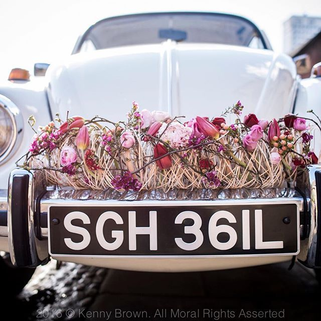 Pretty Pink Contemporary Bridal Wedding Car Decoration With Tulips And Ranunculi
