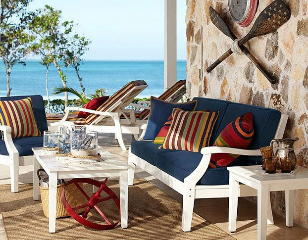 White Patio Furniture With Blue Cushions And Accent Pillows.
