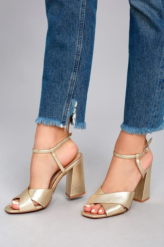58c58abf777c We love the glitz and glam of the Chinese Laundry Low Light Gold High Heel  Sandals! Metallic genuine leather bands cross over a peep-toe upper
