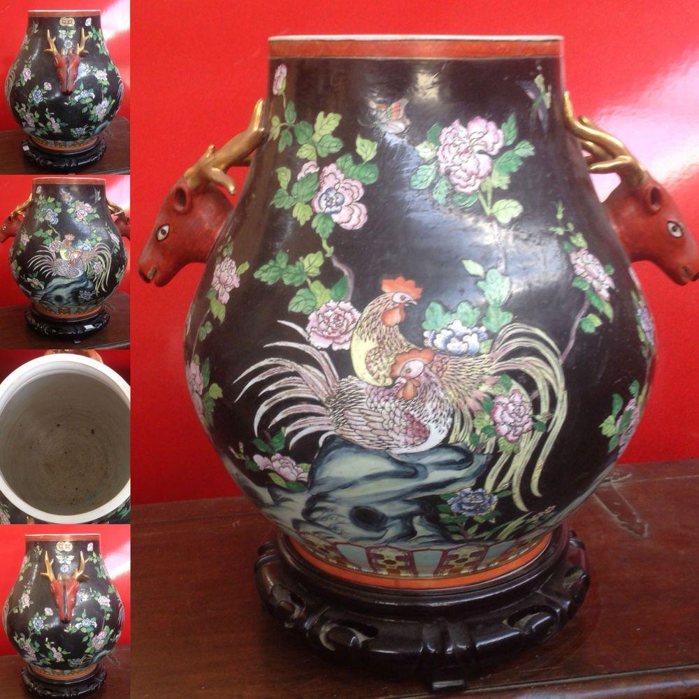 grand vase aquarium,anses tête d'animaux à corne,décor combat de coq .XX siècle.