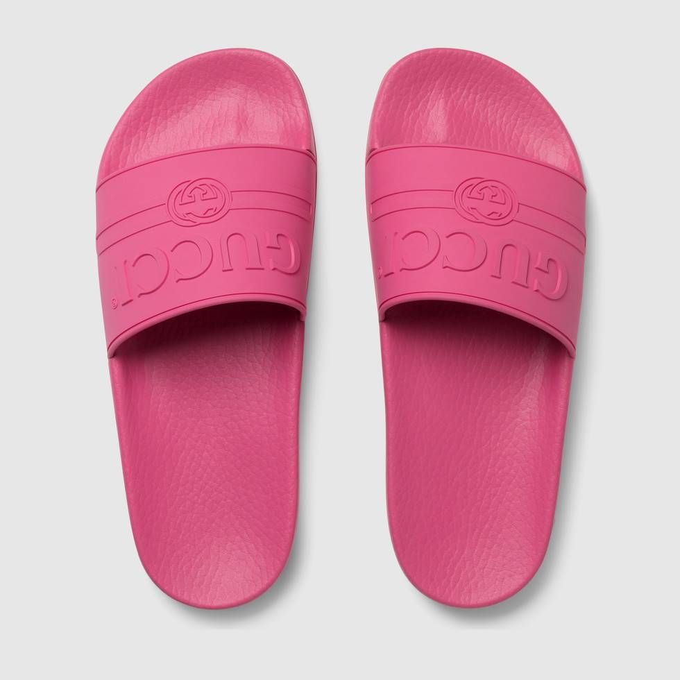 4c26188976b74 Shop the Gucci logo rubber slide sandal by Gucci. Imbued with the summer  feel permeating the Pre-Fall 2018 collection
