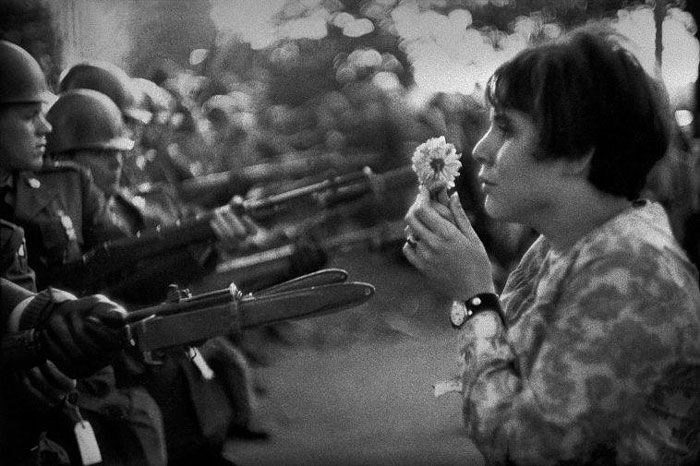 An American young girl, Jan Rose Kasmir, confronts the American National Guard outside the Pentagon during the 1967 anti-Vietnam march. This march helped to turn public opinion against the war in Vietnam.