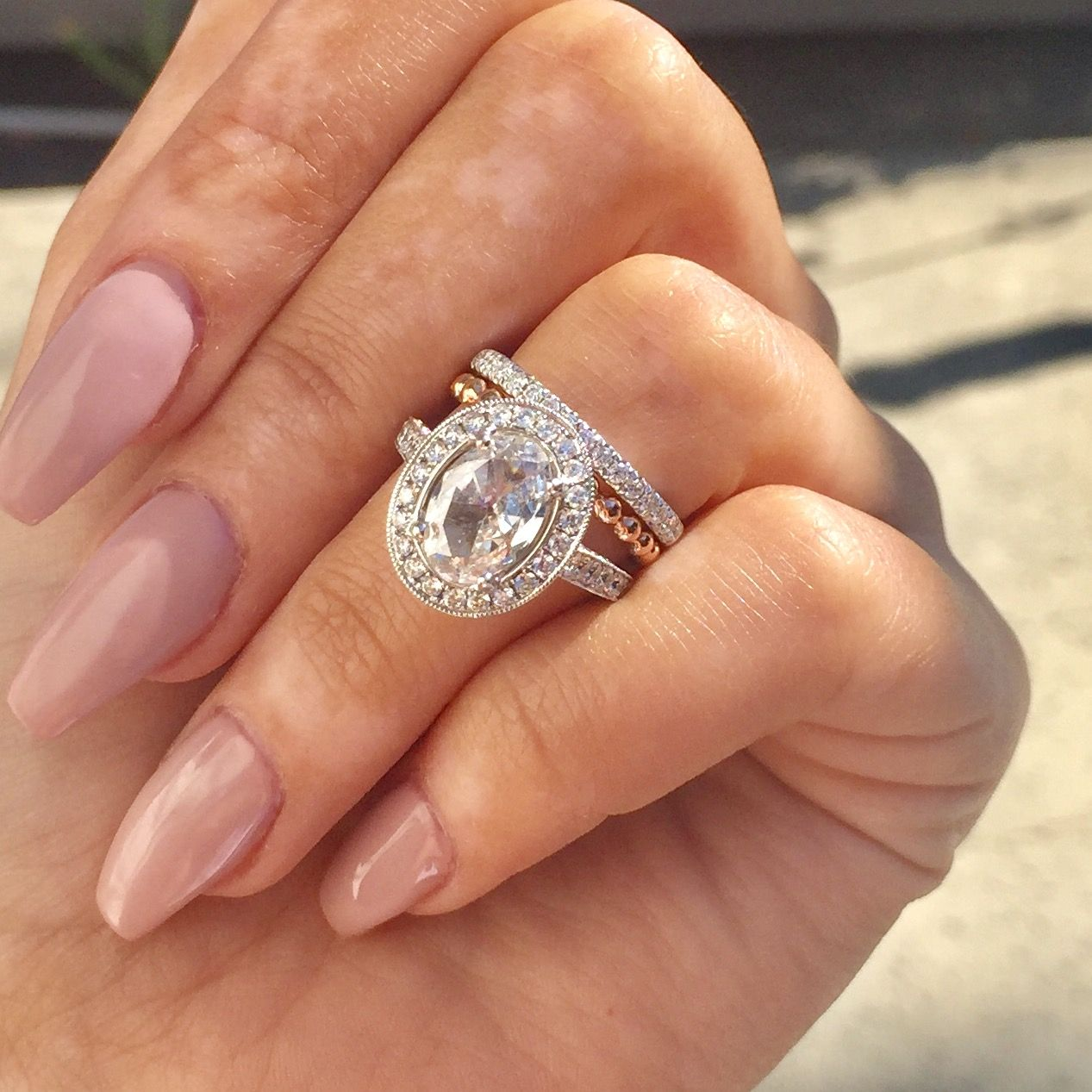 Oval Vintage style diamond engagement ring with milgrain halo