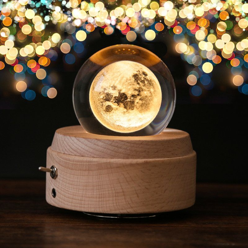 And a crystal ball music box that shows the moon,