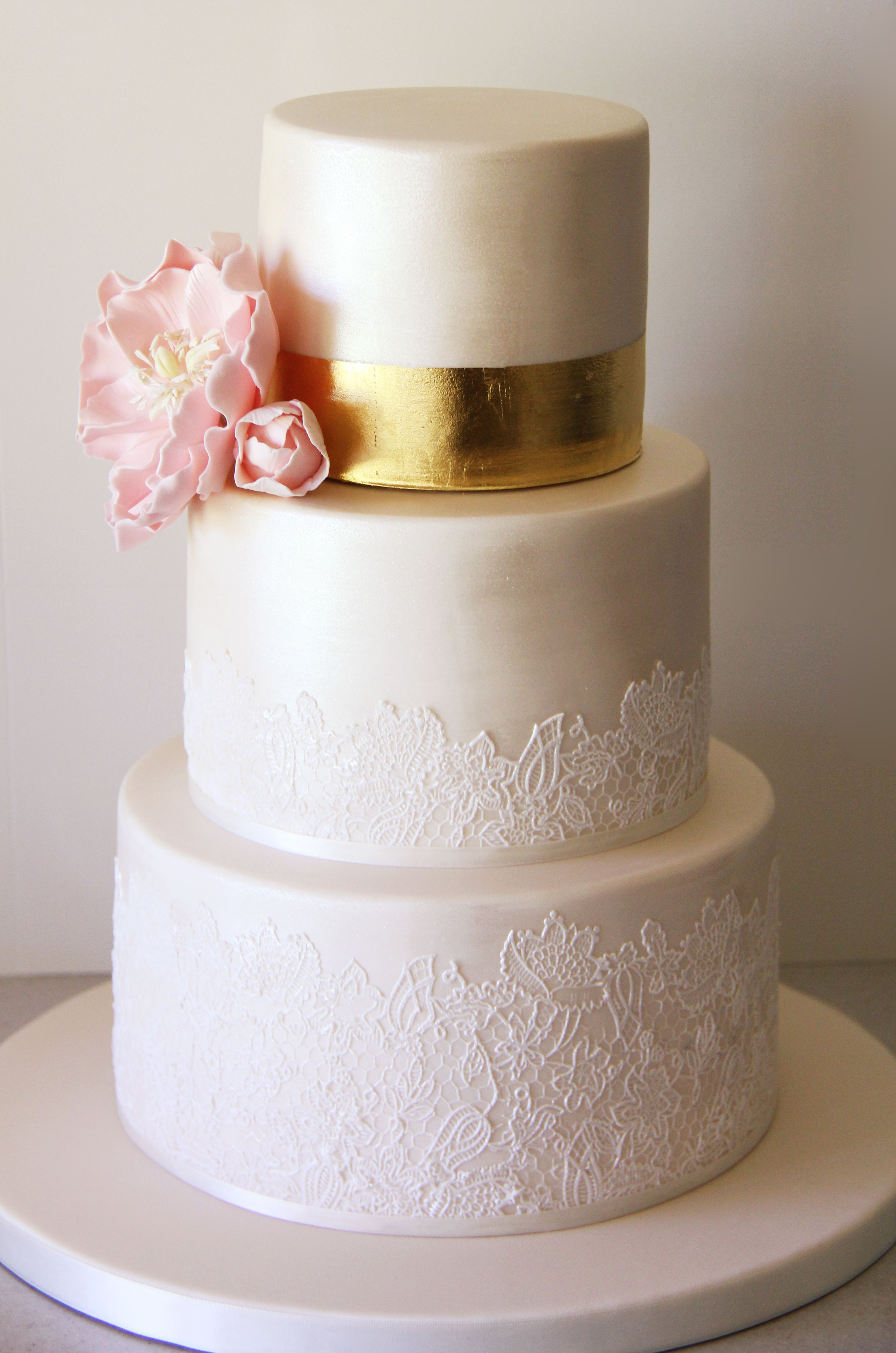Elegant ivory lace wedding cake with gold leaf and pearl shimmer ...
